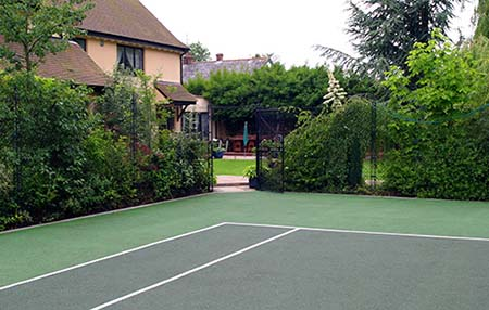 Landscaped home tennis court built by Anglia & Midlands Sports - AMSS