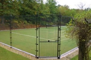 Artificial grass tennis court built by AMSS using Sporturf